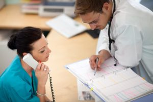 Medical Assistant Looks At Schedule
