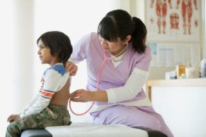 Medical Assistant Listens To Child's Breathing