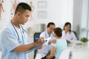 Medical Assistant Helping Doctors During Examination