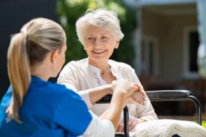 LPN cares for patient in a wheelchair