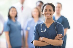 Smiling class of practical nursing trainees